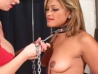 Lesbian submissive in collar and leash