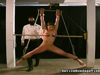 Intricate bondage sees her suffer pain