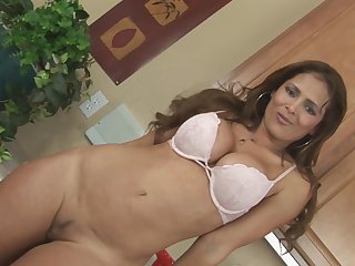 Fake-tit brunette Monique Fuentes is posing