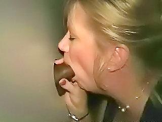 Horny wife sucks BBC at gloryhole