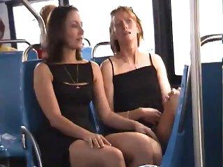 Fun gals kiss on bus