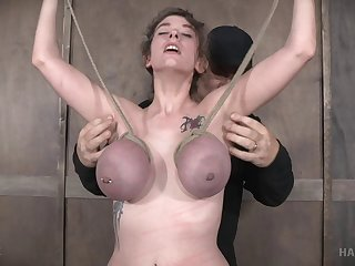 Blindfolded sex slave tied up during a great torture game
