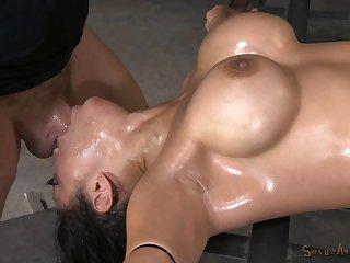 Tattooed bondage maiden gets facial cumshot in BDSM shoot