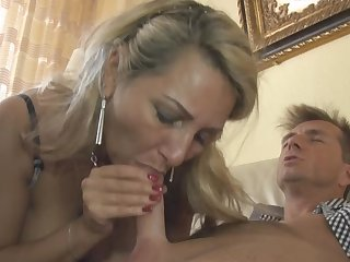 Busty MILF with big boobies Bijenny is getting a hot facial shot in close-up video