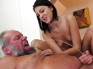 Hardcore brunette milf Meg Magic is fucking her puss with a fist and pissing with insane pleasure