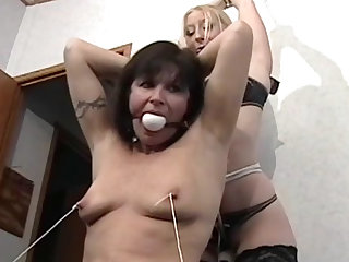 Remarkable humiliation for a stunning milf brunette from her blonde sister with leather whip