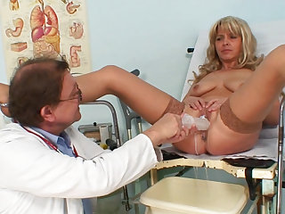 The old blonde disrobes and lets him examine her body in invasive and wonderful ways.