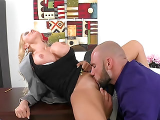 She has impressive implants and Charity McLain gets laid by a big dick dude in the office.