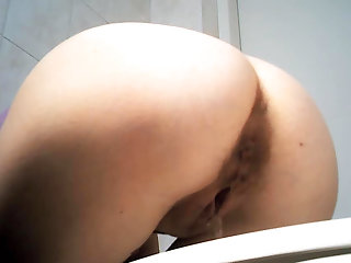 Cute babe with juicy ass is demonstrating her sweet booty in the toilet so sexy