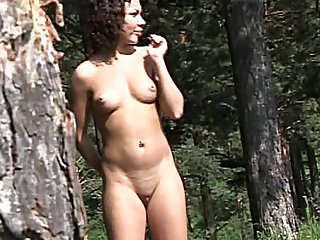 She has sexy thighs and a nice tummy and goes for a piss in her outdoor voyeur video.
