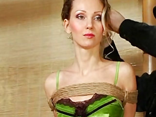 The green lingerie hangs on her tight skinny body beautifully and the rope bondage is sexy too.