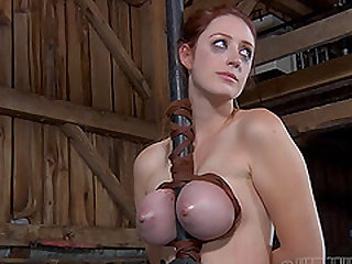 Holly Wildes' tits squeezed by restrains during a kinky game