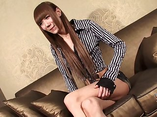 Skinny Japanese tranny stripping and stroking