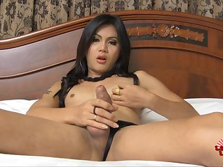 With her cock throbbing hard this Asian tranny plays with her asshole
