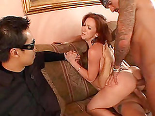 Redhead drilled with a couple of rods during a cuckold game