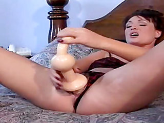 Billie Britt takes a ridiculously big dildo into her pussy and ass in preparation