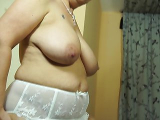 Mature  model with big boobs masturbates with a vibrator solo shoot