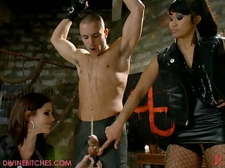 Two sexy Misstresses have a guy caught by his balls