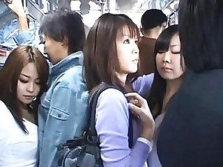 Japanese AV Model gives a handjob to a horny guy in a public bus