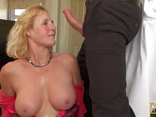 Milf in a pretty cardigan used as a sex slave by her dom