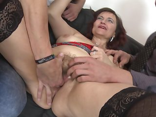 Old lady in red lipstick blows and bones two guys