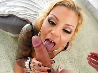 Inked blonde Britney Shannon is licking this dick