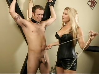 Blonde dominatrix tortures her slaves's dick and ass