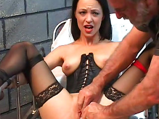 Sweet brunette being humiliated with force in BDSM scene