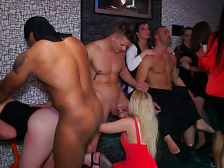 Sexy babe gets cum over her face at the night club party