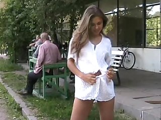 nice looking cutie Olga undressing herself in a public place