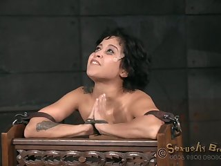 Short-haired cutie gets an arousing bdsm treatment