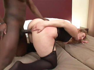 Cock-sucking whitey with nice face is banging in her shaved pussy with hard dark pipe