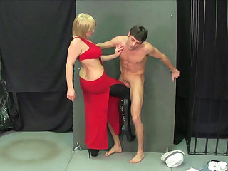 Cute guy with nice abs is getting his balls busted by a chubby blonde