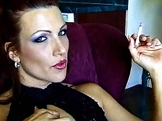 Absolutely gorgeous looking milf playing with her sexy pussy while smoking cigarette in a sexy way