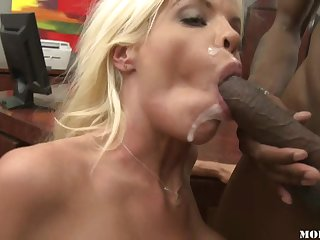The bimbo blonde babe with fake tits sucks black cock and they have great interracial hardcore.