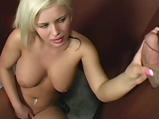 The voluptuous cocksucking talent gobbles shaft through this gloryhole and it cums.