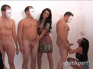 The naked and masked men are tasked with masturbating and getting stroked by hotties.