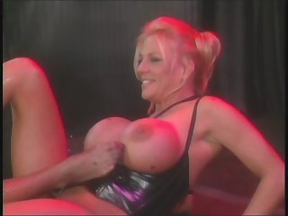 Amber Michaels and Sindee Coxx perform in vintage lesbian porn from the 90s.