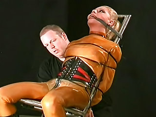 She is beautiful and submissive and her rubber and leather outfit in the dungeon is hot.