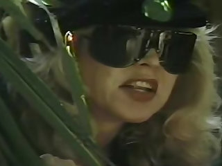 Check out this smoking hot blonde MILF in a uniform going through some bondage on the couch in this vintage video.