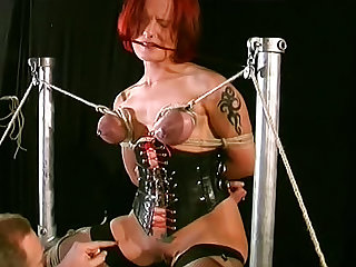 Have a look at this MILF redhead with natural tits in stockings receiving some pain in this BDSM video