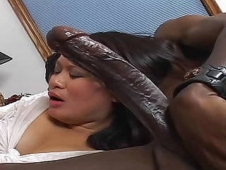 This Asian babe will be sucking balls and giving an amazing blowjob to this big black cock in this interracial video.