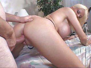 Watch Carson Carmichael ins this hardcore video in which she's giving a blowjob, a titjob and then getting fucked doggy style on the bed.