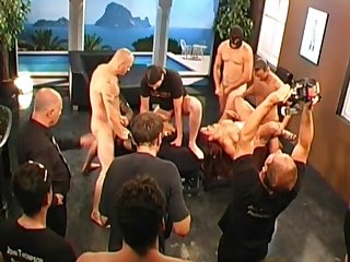 German backstage footage of a hardcore gangbang scene with hot brunette and a lot of big dicks.