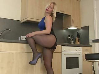 This hot housewife loves masturbating in her kitchen