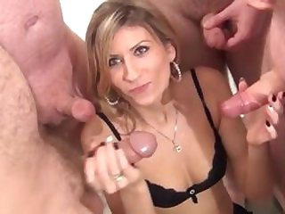 Sexy blonde Anastasia takes facials in a bukkake