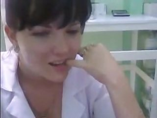 Naughty nurse strips for a webcam at work