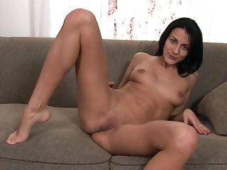 Beautiful brunette Czech girl with shaved pussy Naomi Montana enjoys masturbating while being all alone in her room.