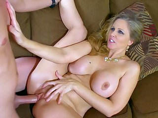 Appealing Julia Ann spreads legs for her step son and enjoys his dick in a serious couch fuck, all to complete her mind blowing oral scenes