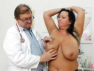 Lustful amazing Robislava is allowing her gyno doctor to stretch her shaved pussy